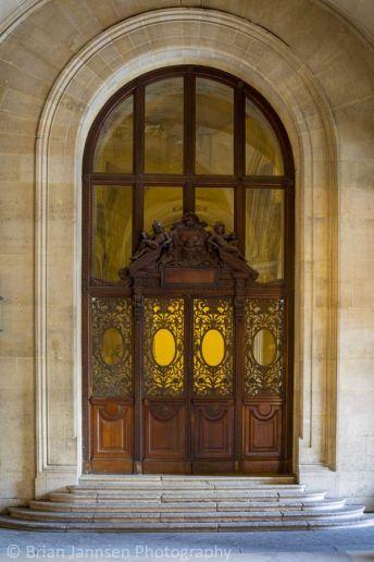 Ornate doorway at Musee du Louvre, Paris France